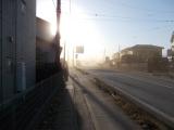 砂煙に霞む太陽