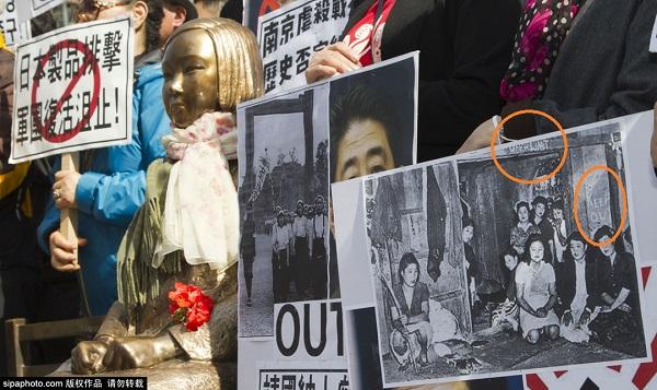 壁面などに英語で「OFF Limit」や「KEEP OUT」と書かれた朝鮮戦争時代の米軍向け慰安所と韓国人慰安婦の写真パネルを掲げて反日デモをするマヌケな韓国民衆(4月1日、ソウルの在韓日本国大使館前)