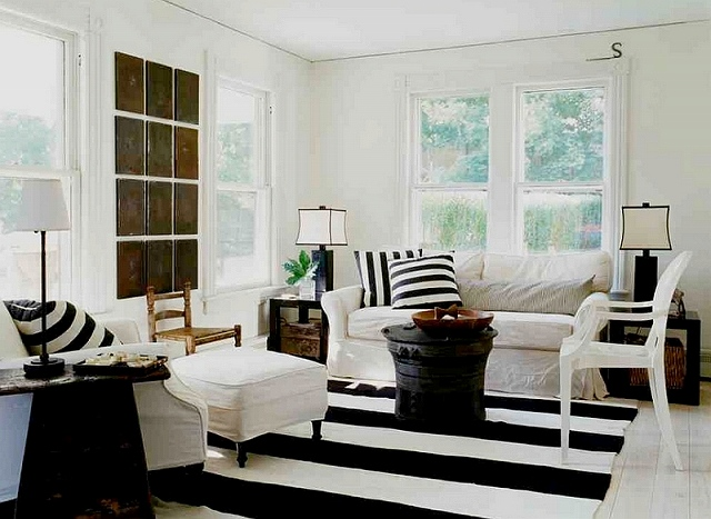 Beach-style-meets-chic-farmhouse-appeal-in-this-cool-black-and-white-living-room.jpg