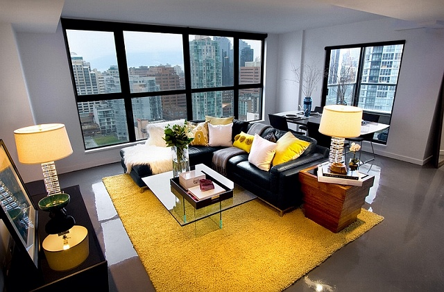 Black-couch-adds-visual-punch-to-the-living-room-in-yellow-and-grey.jpg