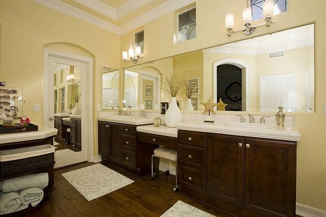 Dark-walnut-vanity-adds-to-the-warmth-of-the-bathroom_20150313070719161.jpg