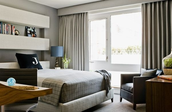 Drapery-and-bedding-fabric-add-to-the-elegant-color-scheme-of-the-boys-bedroom.jpg