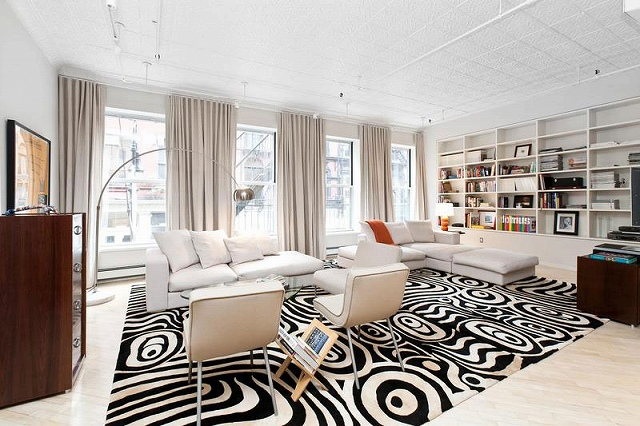 Living-room-of-Chic-Soho-Style-apartment-keeps-the-focus-on-white.jpg