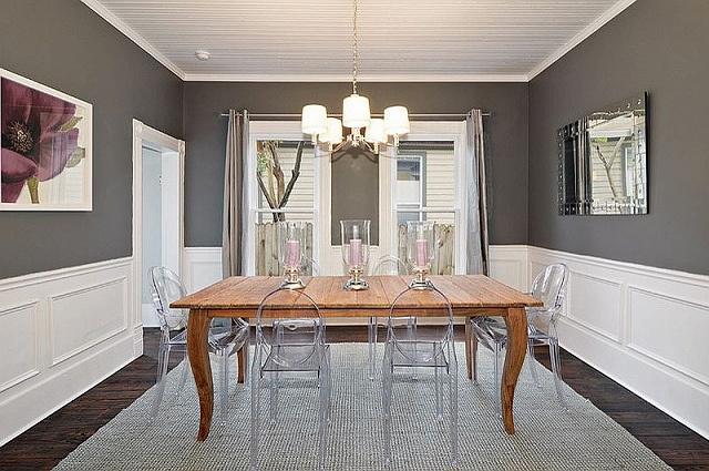 Lovely-charcoal-gray-dining-room-with-acrylic-chairs-and-wooden-table.jpg