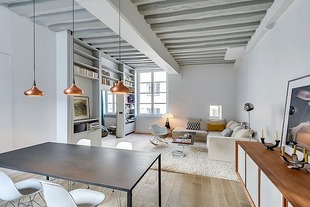 Painted-ceiling-beams-add-to-the-classic-appeal-of-the-small-apartment.jpg