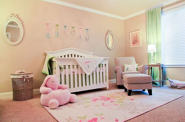 Soft-peachy-pink-and-green-shape-the-nursery-inspired-by-English-countryside.jpg