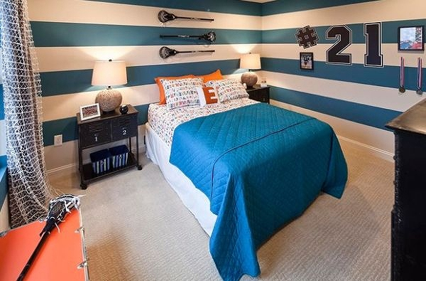 Striped-blue-and-white-walls-brings-sophistication-to-the-room.jpg