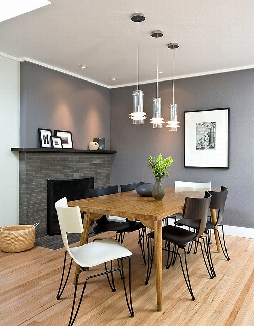 Stylish-chairs-and-a-gorgeous-gray-backdrop-shape-the-contemporary-dining-room.jpg