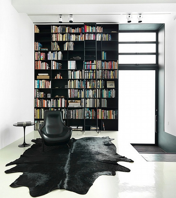 Uber-stylish-blacka-nd-white-living-room-with-a-giant-bookshelf-that-defines-the-space.jpg