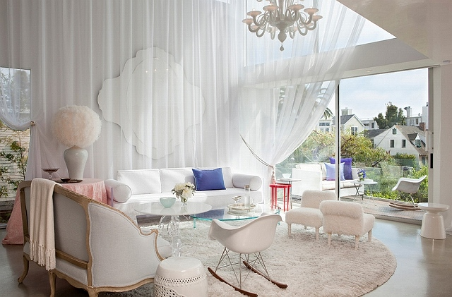 White-drapes-and-cozy-decor-give-the-spacious-room-a-trendy-feminine-look.jpg