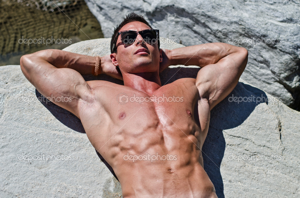 depositphotos_29249517-Attractive-young-muscle-man-sunbathing-on-rock.jpg